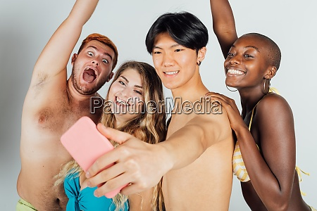 friends taking a selfie partially clothed