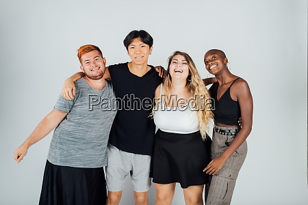 studio portrait four young adult friends