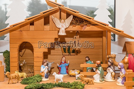 wooden crib with painted crib figures