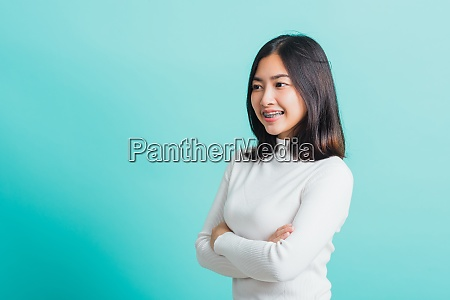 woman smiling with crossed arms