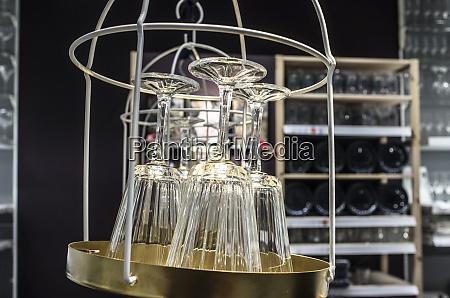empty new wine glasses hanging over