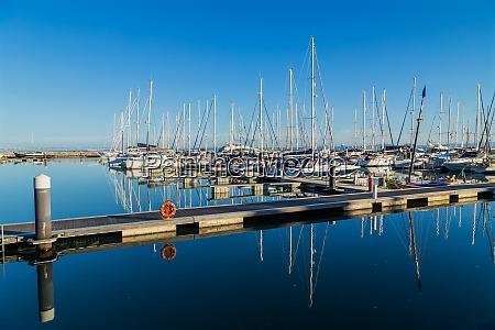 yachts docking at marina