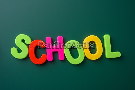 inscription school from multicolored plastic letters