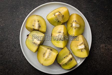 halved ripe yellow kiwi fruit