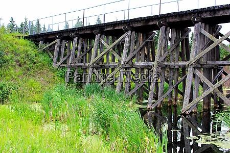 an old trestle railroad bridge spanning