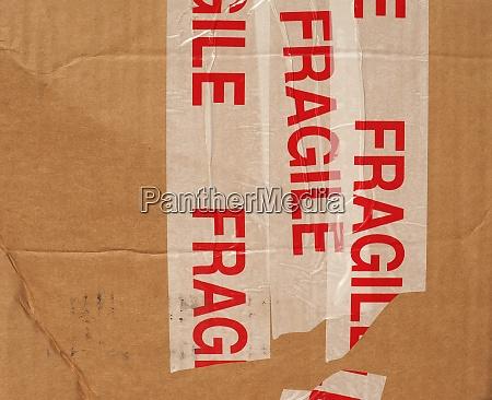 fragile on cardboard packet