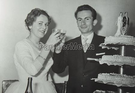 newlyweds with wedding cake 60s 5