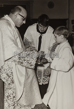 young boy firts communion