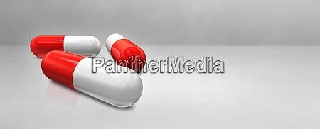 capsule pill on a white concrete
