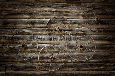 old metal wheels on a wall