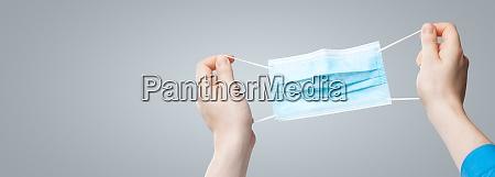 hands in medical gloves hold medical