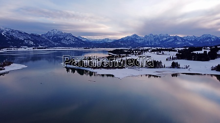 aerial drone shot of forggensee lake