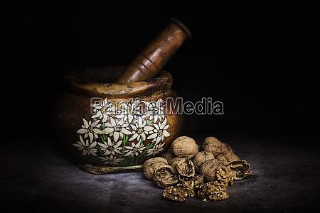 handmade wooden mortar with alpine decorations