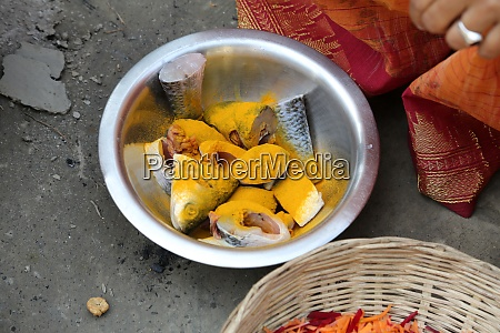 preparing spicy and hot fish curry
