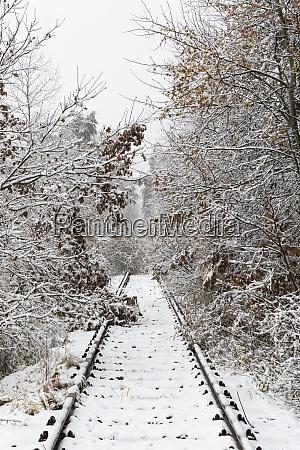 snowy canceled old railway track