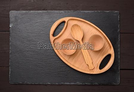 empty oval brown wooden tray board