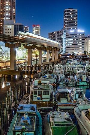 ships and tokyo skyline sunset