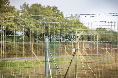 double barbed wire mesh protecting military