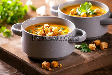 bowls of homemade soup with organic