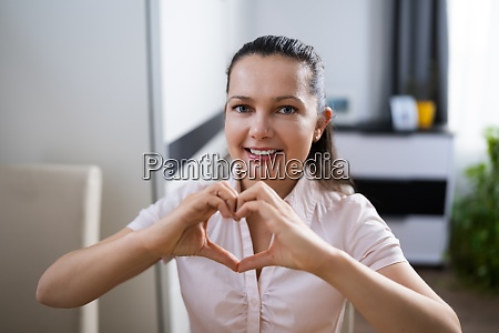 woman hand forming heart