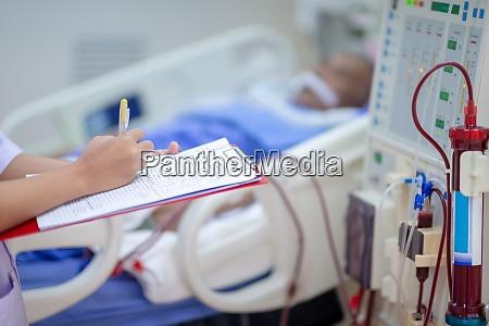 dialysis nurse are checking dialysis machine