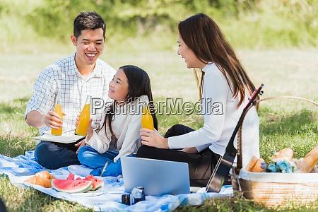 happy family having fun outdoor sitting
