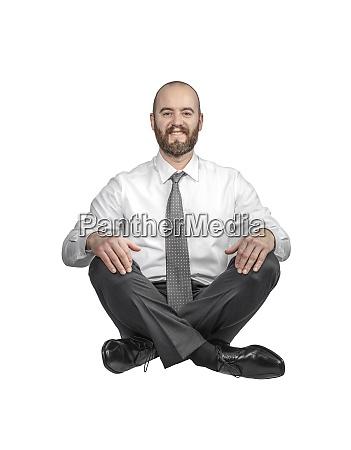 smiling crossed legs seated businessman