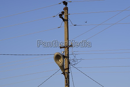 power line post with a street