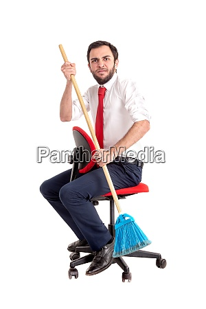 businessman rowing with a broom