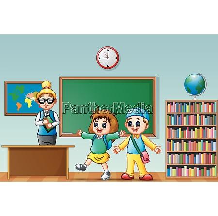 happy school kids with female teacher