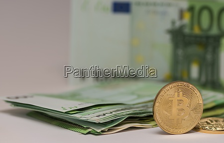 standing bitcoin with many 100 euro