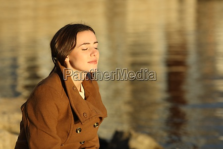 relaxed woman in winter breathing fresh