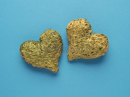 two hearts made of straw on