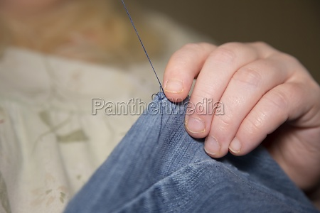 sewing blue jeans