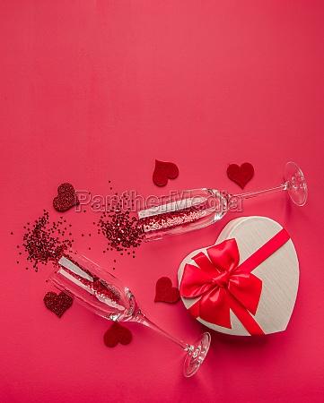 two champagne glasses with confetti