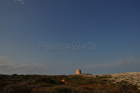 landscape on menorca with torre dalcalfar