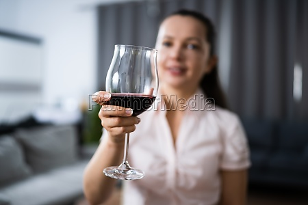 woman drinking red wine in video