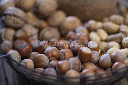 still life with hazelnut peanuts walnut