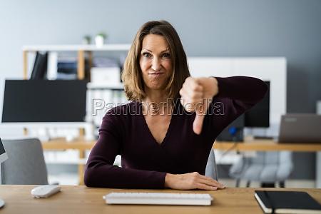 woman portrait showing dislike thumbs down
