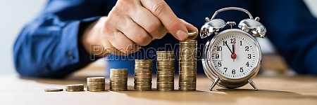 quick money stopwatch and cash growth