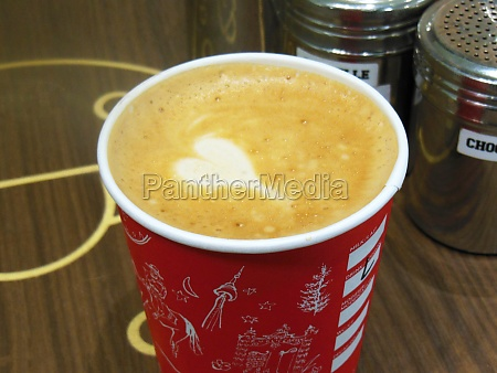 white foam heart in latte coffee
