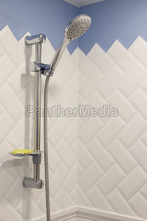 modern shower on wall rail in