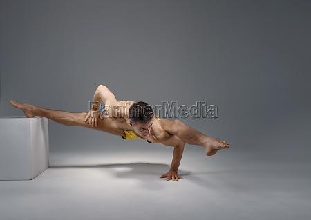 muscular yoga keeps balanc on the