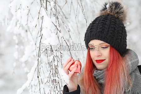 smiling red hair girl is looking