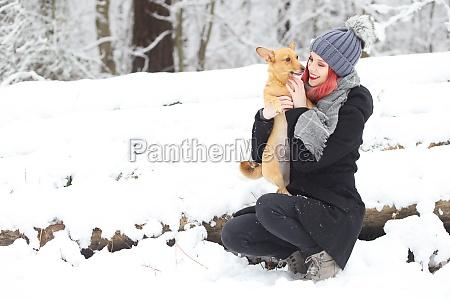 smiling red hair girl is cuddling