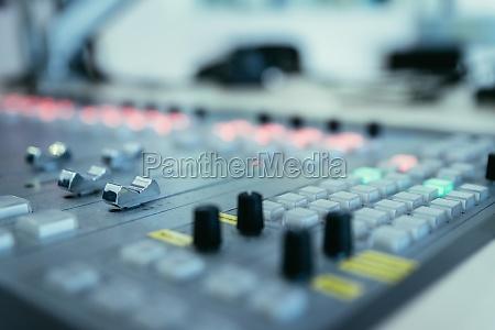 radio broadcasting studio soundboard and computers