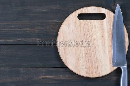 kitchen knife on wooden round cutting