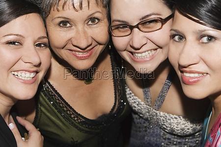 portrait of four women smiling
