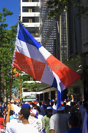 crowd waving the dominican republic flags