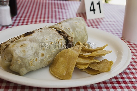 front view of burrito and chips